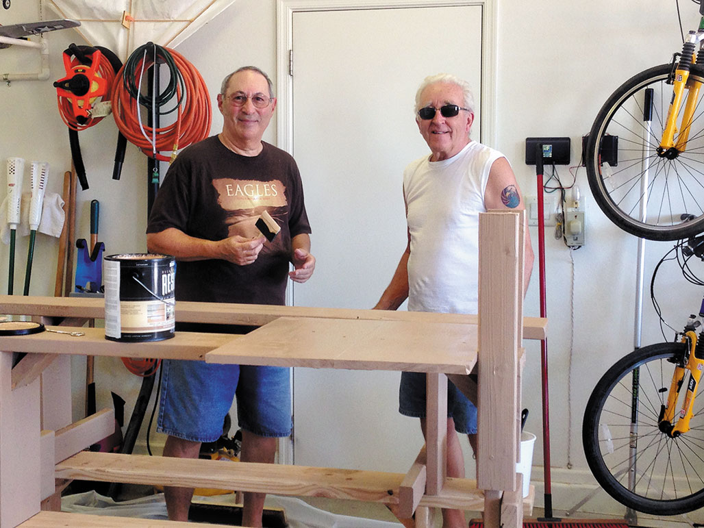 Alan Friedman, left, and Marv Enerson complete work on benches and flight tables for the club field.