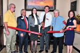 The ribbon cutting for Secure Retirement. Photo by Charlene Rule.