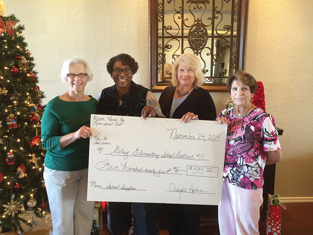 Members of the RR Ladies Social Club presented a check to the Eloy School District Superintendent.
