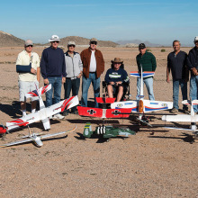 The motley crew showing off the club's fleet.