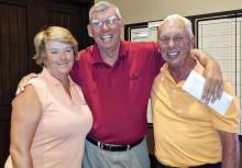 Flight one, first place: Susan Worner, John DeChristopher, owner, and Tom Landin