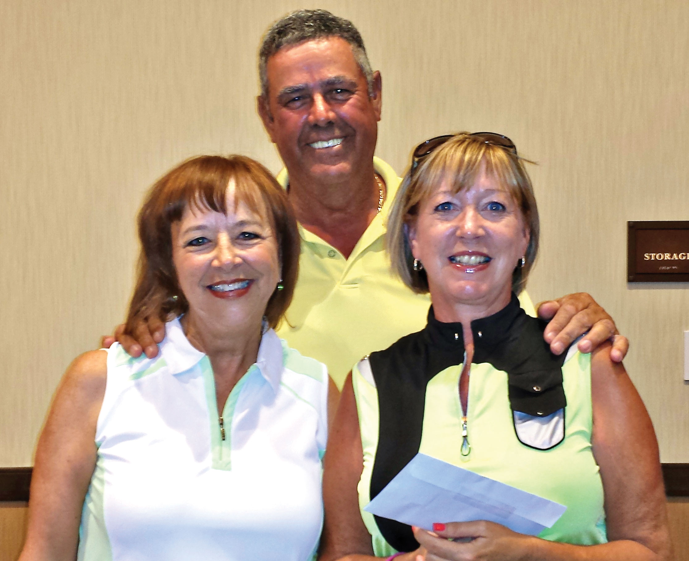 Flight two, first place: Jan Stocek, Jim Osborne and Barbara Gayer, owner