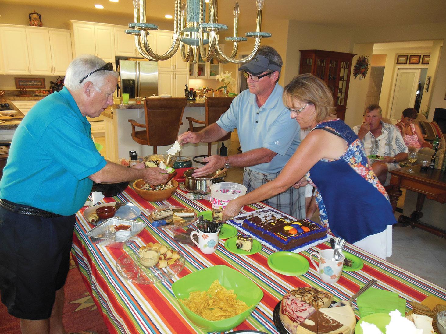 Bob Burton, Jeff and Layne Jones dishing up the cake and ice cream.