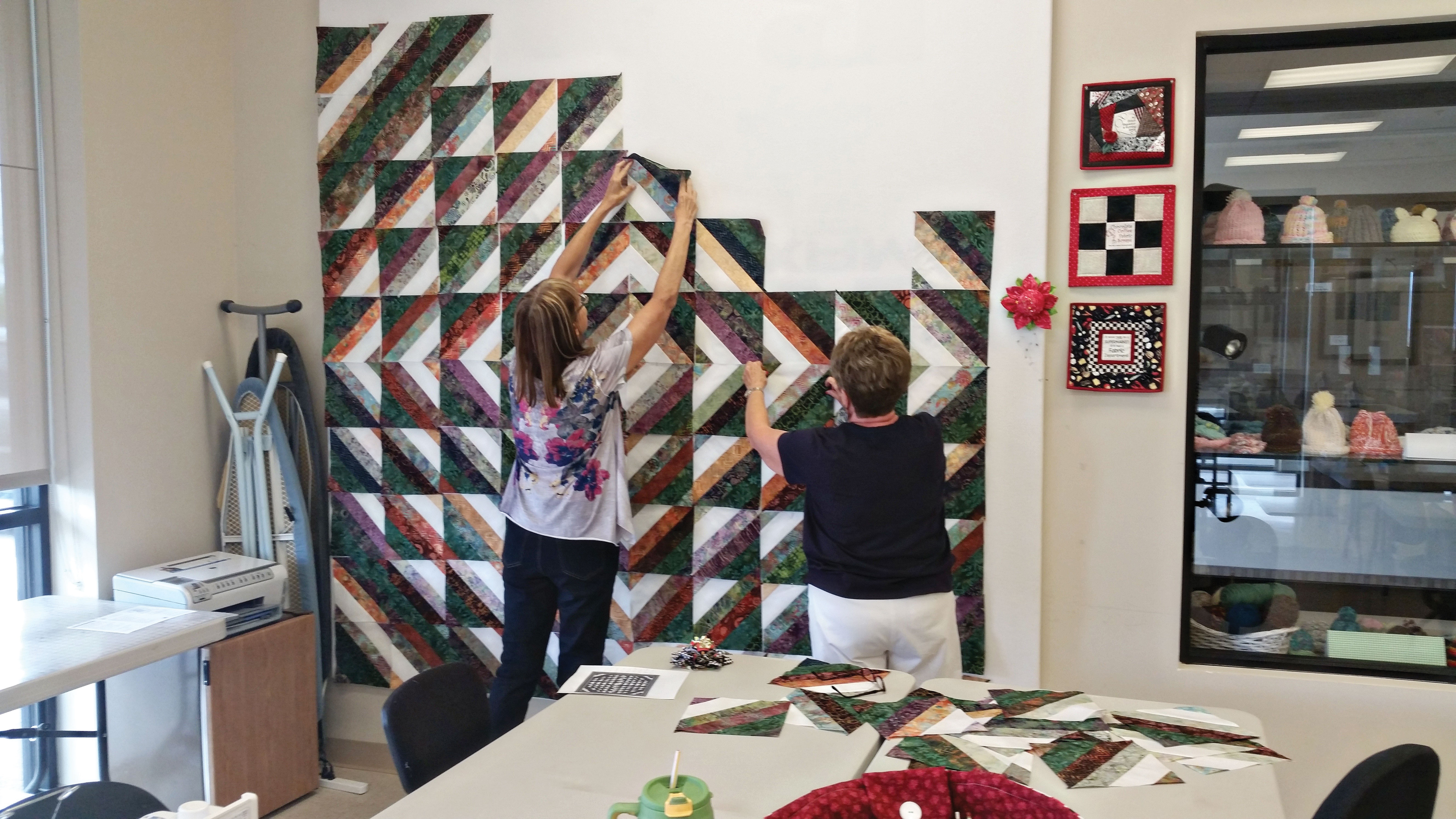 Beverly Haffer and Fran Browe work on our next raffle quilt.