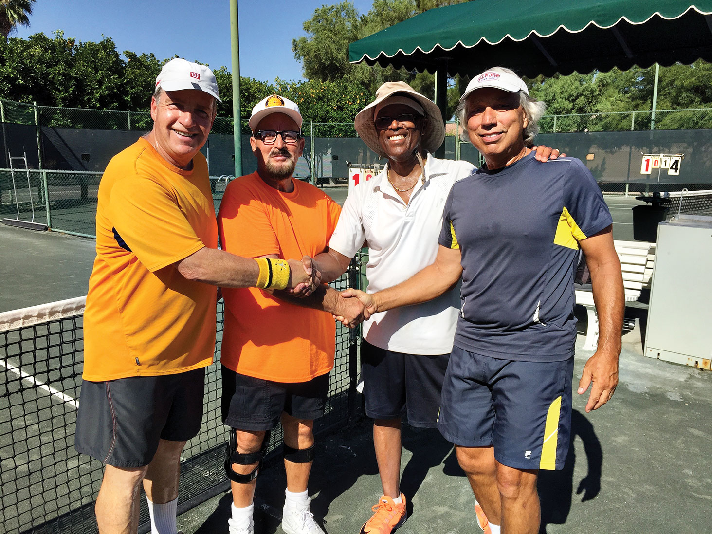 Rami Mayron and Azaaria Azaria, first place in 6.0 Men's Doubles division; also pictured are Tom and Americus from the IronOaks Club