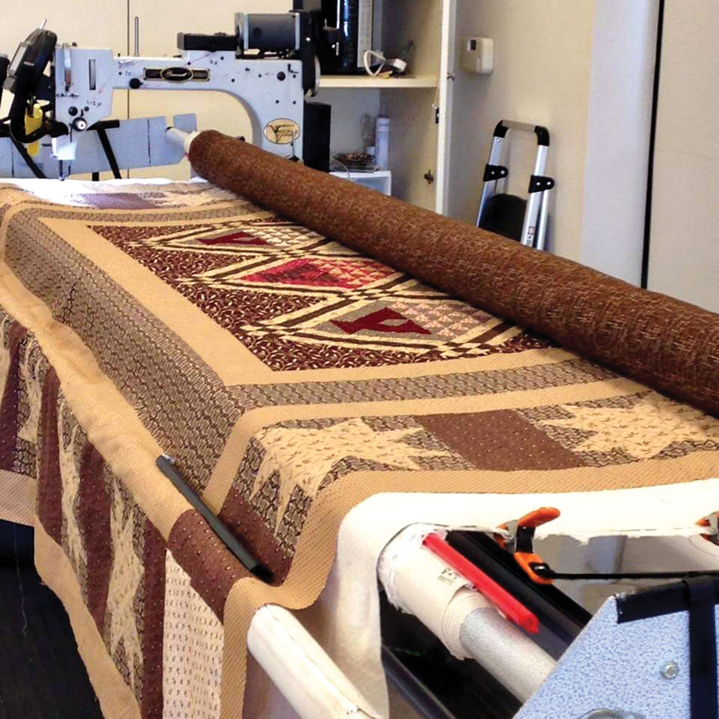 Mary Syer is the designer of this quilt on the longarm quilting machine.