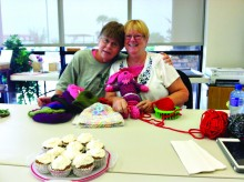 Izzy Ocheltree and Judy Ault are working on chemo hats and toys for children.