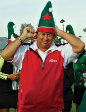 Pro Jay Wilson putting on elf hat for Green Team