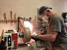 Chips fly as Ron Hay turns a larger Mesquite bowl.
