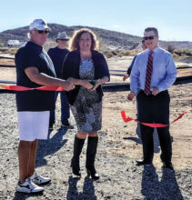 Dave Hudson, Melani Caron and Jeremy Smith participate in the ribbon cutting for the new RC Park.