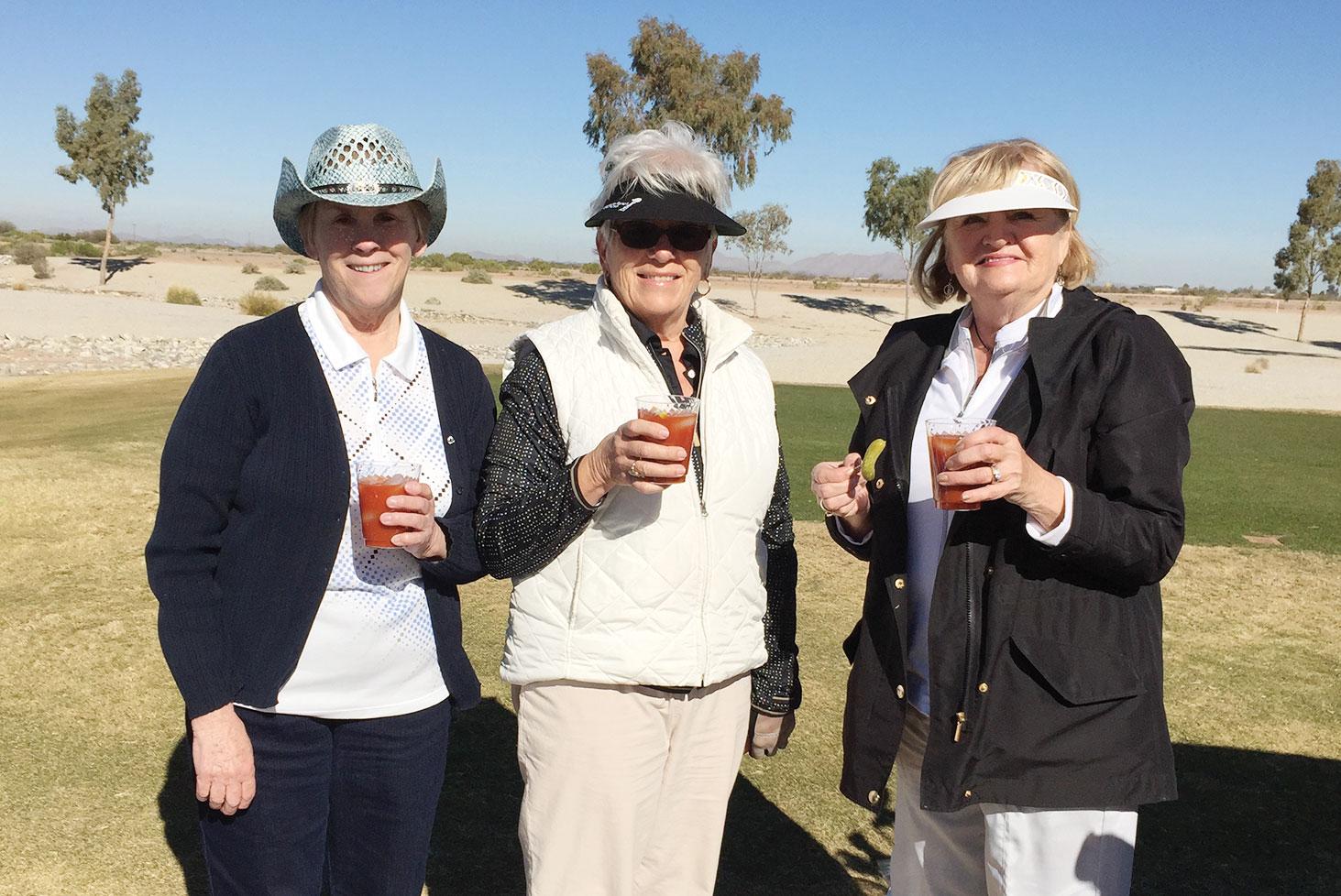 Group of three celebrating a birdie with Bloody Marys: Sandy Horzauk, Karen Zuniga and Jeri Srenaski.