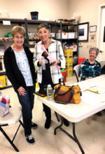 """Ceramics and Pottery Club 2017 President Agnes Wilson receives a gavel and """"Madam Pres"""" sash from 2016 President Kathy Foran."""