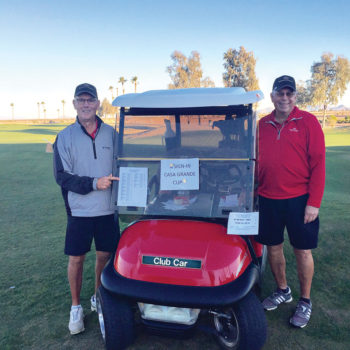 Don Juillerat and Russ Stocek ready to check in golfers