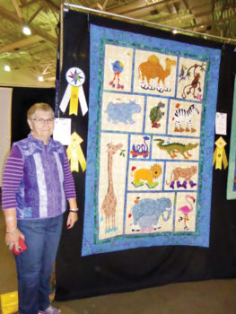 Jackie Marshall with both of her third place ribbons at the Tucson Quilt Show
