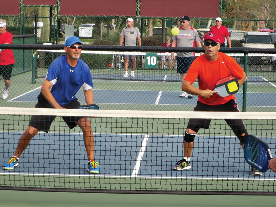 Lloyd Muth and Ron Hunt on their way to Silver in Men's Doubles 4.0 plus