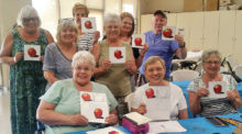 The Fine Arts Guild closed out its 2016-2017 season with a Colored Pencil Class. Nine of the 15 students are pictured above with their colored pencil painting of an apple.