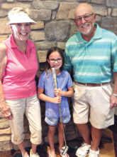 Sandy, granddaughter Chloe, and Dick Christopher participate in the putting league on June 8.
