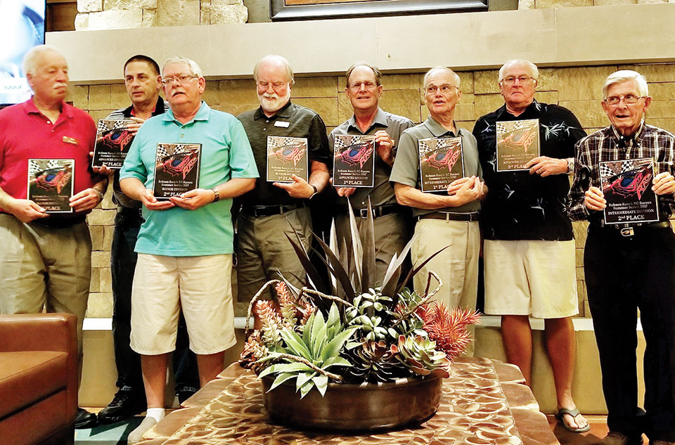 Award winners, left to right: Ron Schroer, Mark McCollum, Dave Doughty, Ralph Sanks, Bill White, Richard King, Dave Hudson and Neal Evans