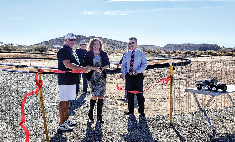 Melani Caron, HOA general manager, presides over the ribbon cutting ceremony for the Robson Ranch RC Park.