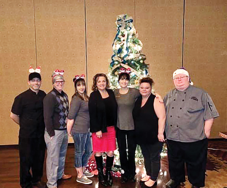 Shown from left: Sous Chef Stephon; Sous Chef Mary; Restaurant Manager Jody; Melani, general manager; Sara, restaurant manager; and Chef Jay. Missing: Jon, landscape superintendent; Kacey, maintenance supervisor; and Lois, director of fitness