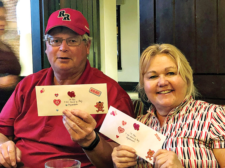 Barb and Bob Wilson, two of the first place winners, who each won a 9-hole round of golf from the Robson Ranch Pro Shop. The other two winners, not shown, were Susan Marian and Cath Lewis.