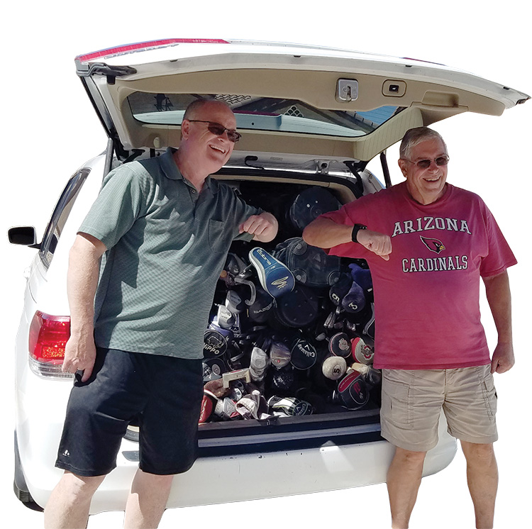 Scott and Russ, elbow-bumping behind a full vanload of stuff.
