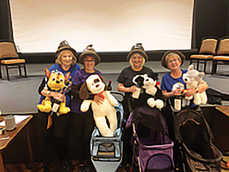 Winter 2020 MasterMind! Feud Most Amazing Team was awarded to the Robson Ranch Dog Park Club (from left): Anne Woods, Bobbie McGuire, Deb Maxwell, and Pam Sanders.