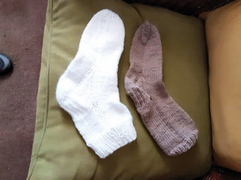 The Needle Crafters sock-ceeded in making two pairs of socks.