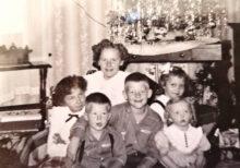 Sandra Ristow, the oldest child, circa 1952, with her Dankemeyer cousins posing near Grandma's tinsel laden tree.