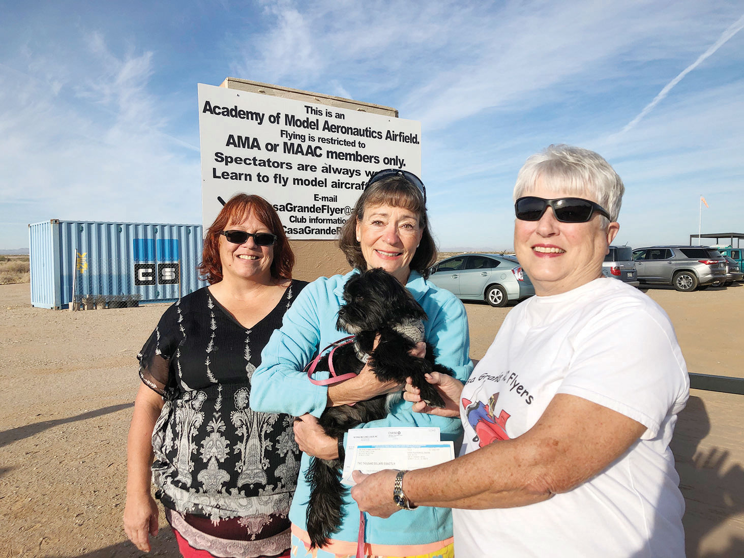 Nancy (right) presenting a donation to Valley Humane Society.