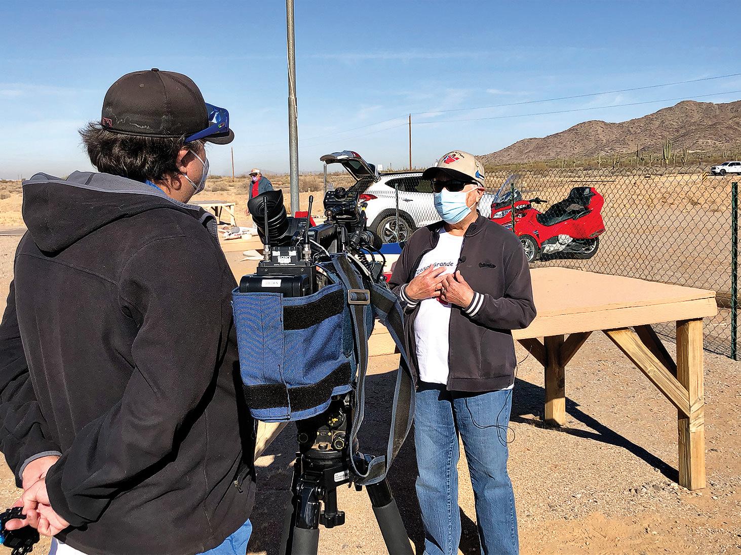 Corey Goodwin interviewing Nancy Friedman at the Casa Grande Club field.