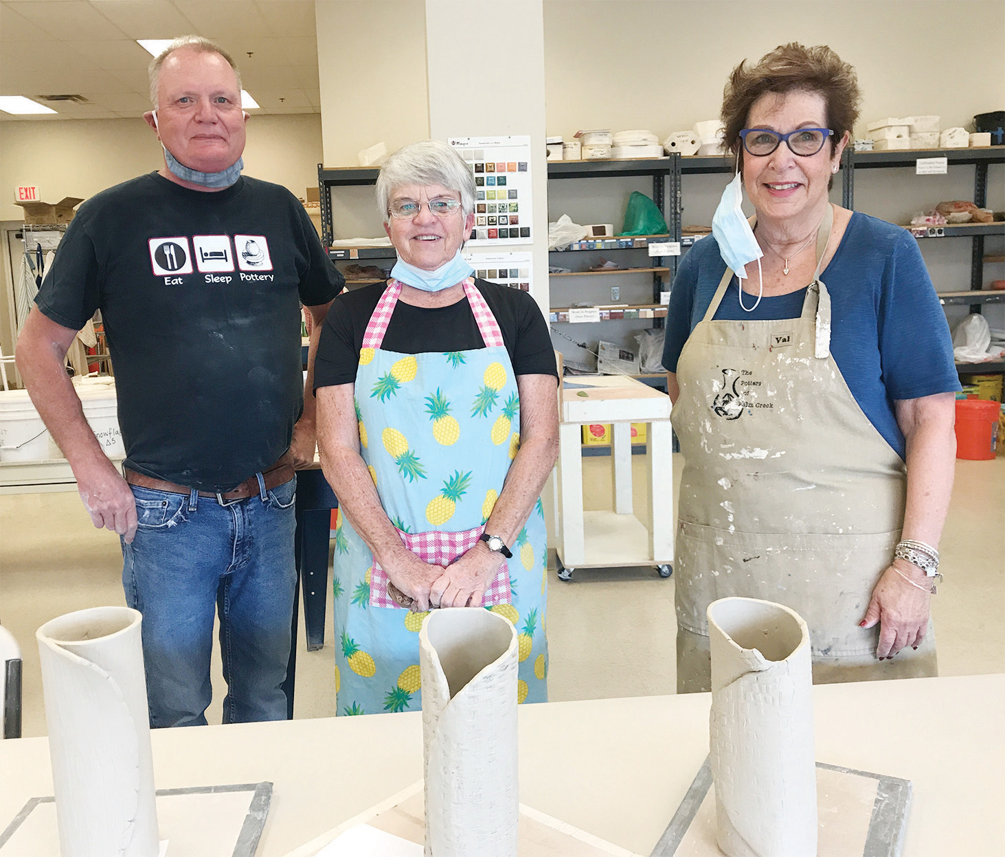Warren Jensen, Diane Oster, Eeda Clow; Class 1: free formed their vase; Class 2: after firing in the kiln, the vase was cleaned and rough spots were sanded.