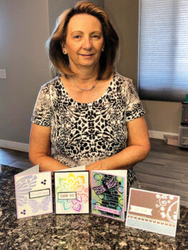 Trudy Foslein shows some of the cards made for the Eloy Food Bank.