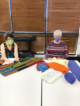 Jeanne and Diana working on lap robes for our Eloy veterans