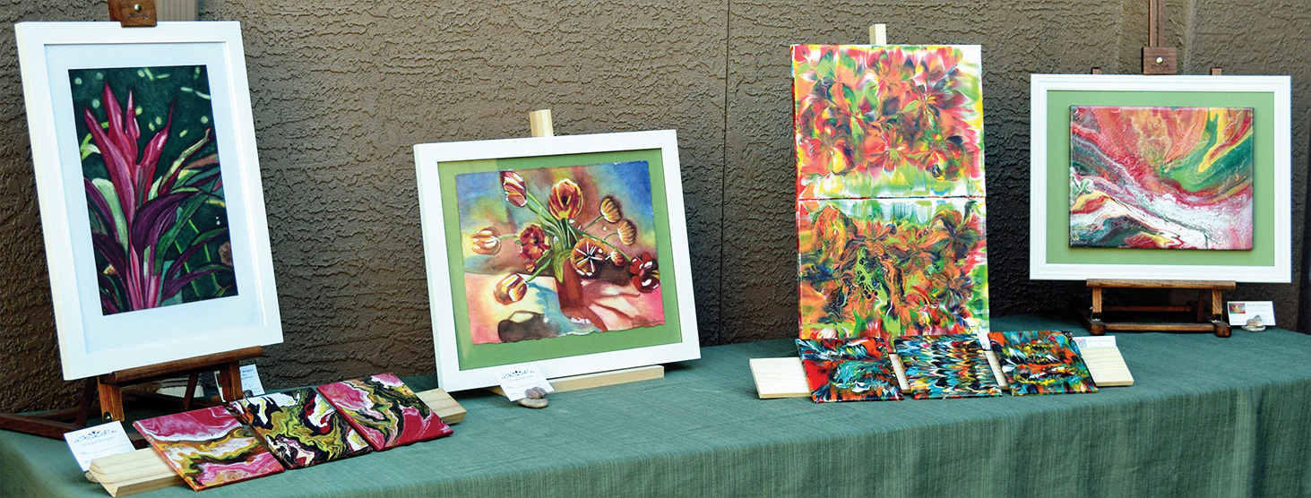 Examples of Janet Buckingham's talent in acrylic pouring and watercolor painting.