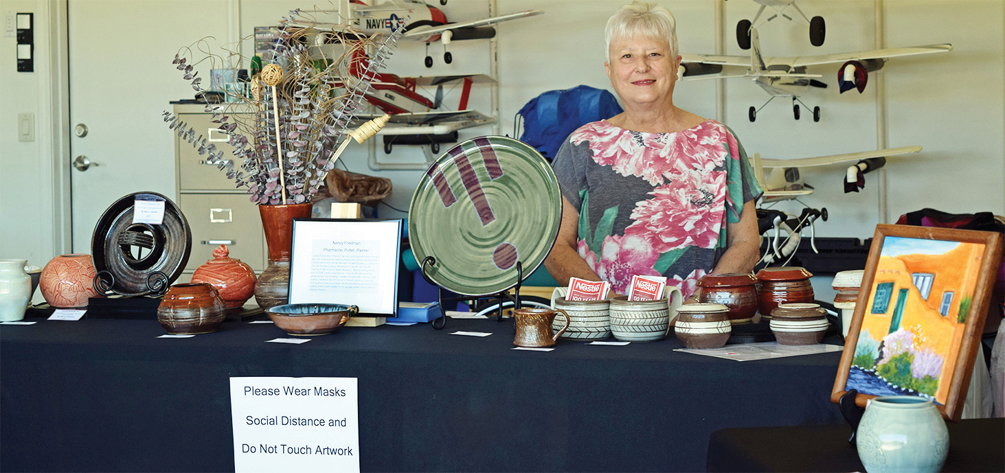 Nancy Friedman displays her pottery along with her paintings in watercolor and acrylics.