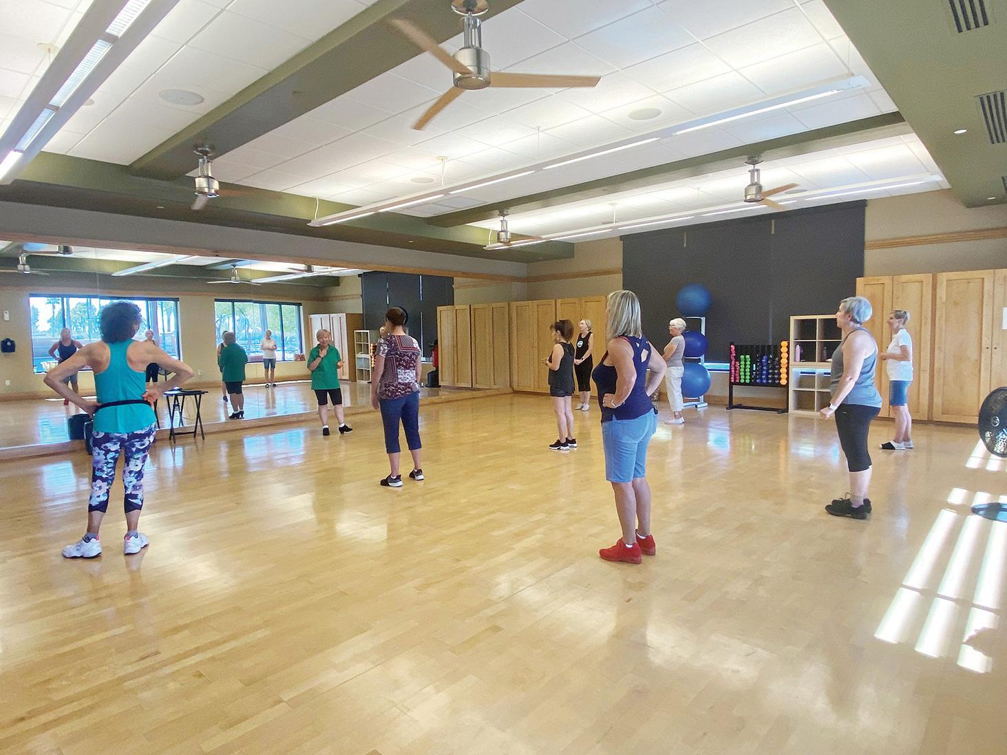 Intermediate class getting steps from instructor, CJ, in the aerobics room.