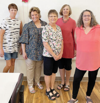 Some of the members wearing their finished tops (left to right): Peg Fortner, Patty Foley, Janita Baugh, Joanne Johnson, and Diane Bohmert.