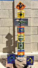 Native American totem/roadrunner/bird on top and two kokopelis garden stakes by Doris Betuel