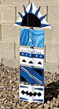 Blue/white totem pole by Michele Chui
