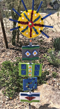 Totem with yellow and blue starburst by Chris Maloney