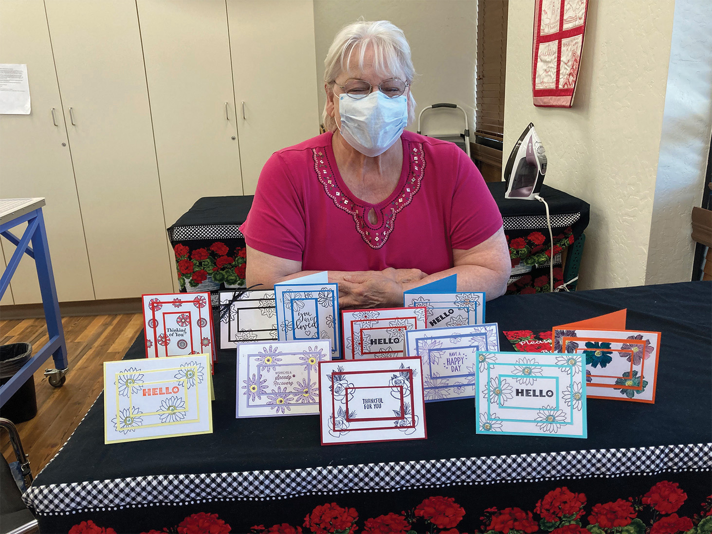Instructor Georgia Brosnihan with finished cards from class.