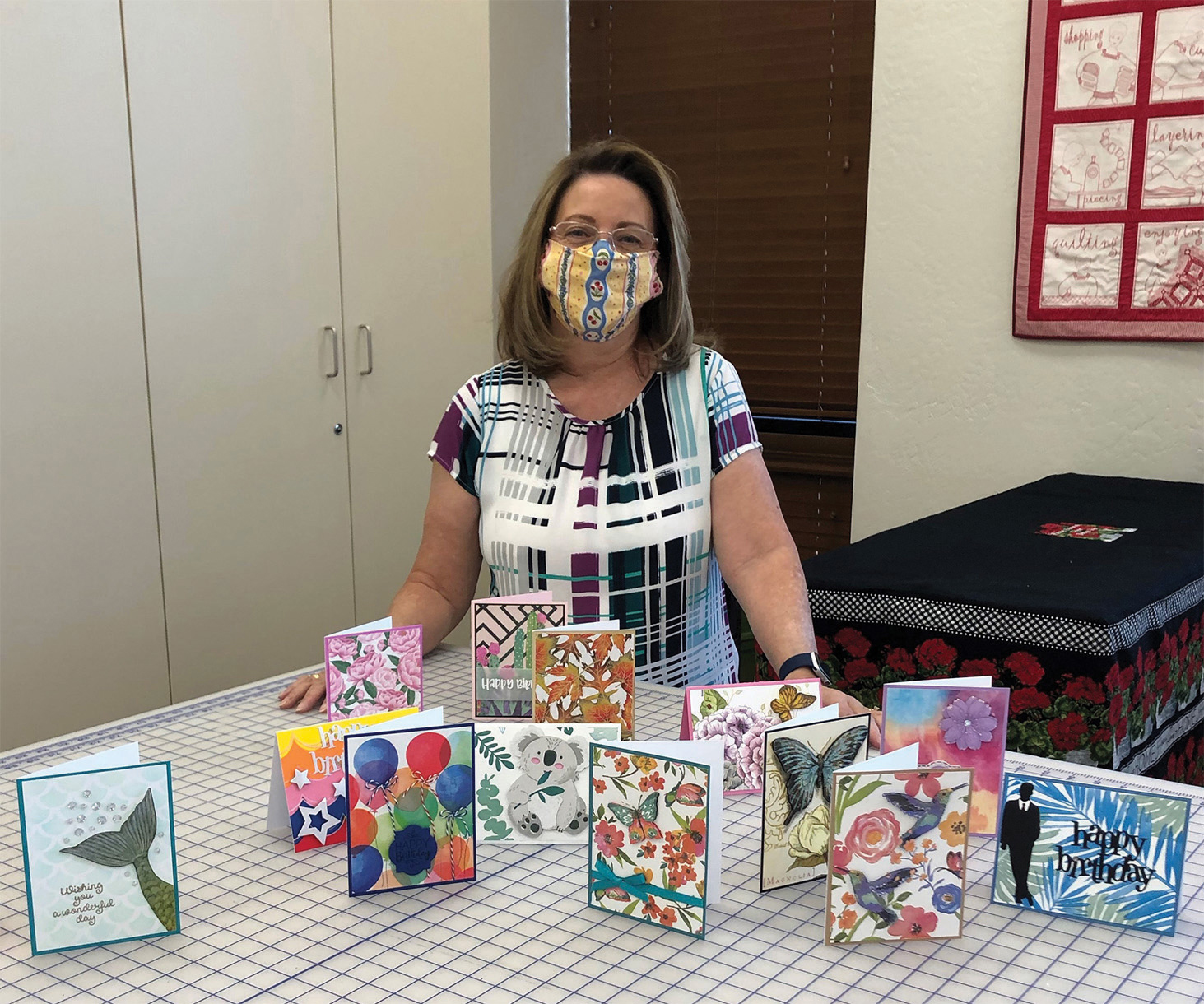 Instructor Trudy Foslein pictured with napkin cards she made.