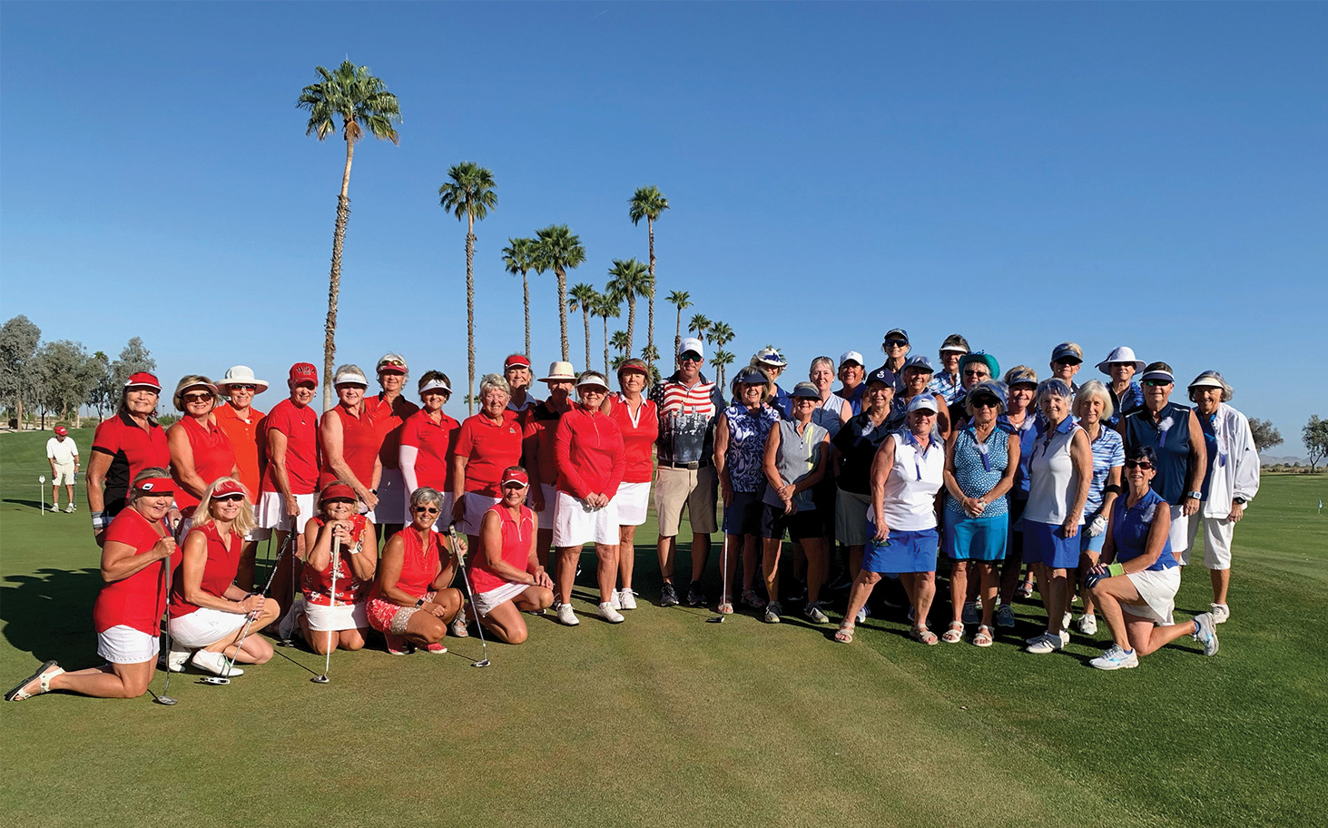 The Red and Blue Teams dressed to win! Golf pro Jay Wilson keeps the two rival teams separated.