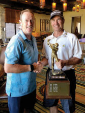 Five time Robson Ranch Arizona Golf Club Champion Jim Baxter with his trophy and Tournament Chairman John Lewis.