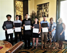 The scholarship recipients pose with the club chairs (left to right): Guillermo Martinez, Emmanuel Lule, Mauricio Lopez, Carissa Juarez, Joaquin Jimenez, Ruby Herman, and Debbie Maxwell.