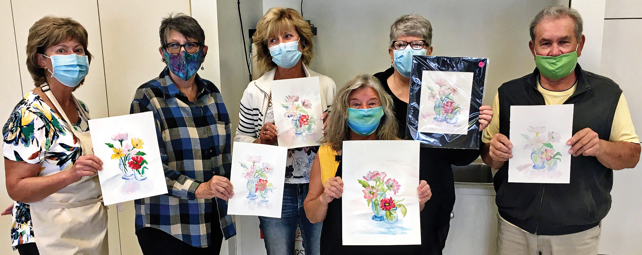 Controlling their water in watercolor painting with the help of Terry Helmstetter are (left to right): Karen Cutrell, Terry, Karen Kulling, Susan Halley, Doreen Beers, and Louie Cano.