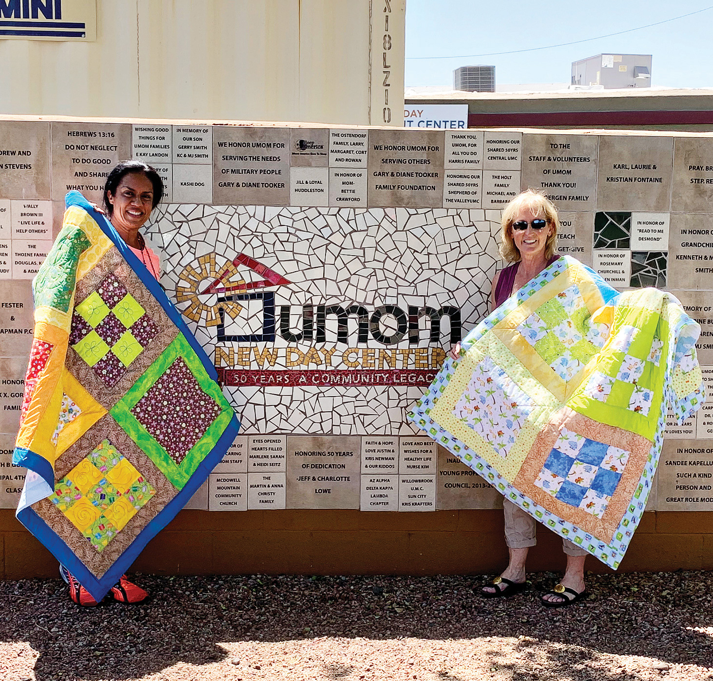 Jody Edwards (right) presented quilts to UMOM in Phoenix at the New Day Center.