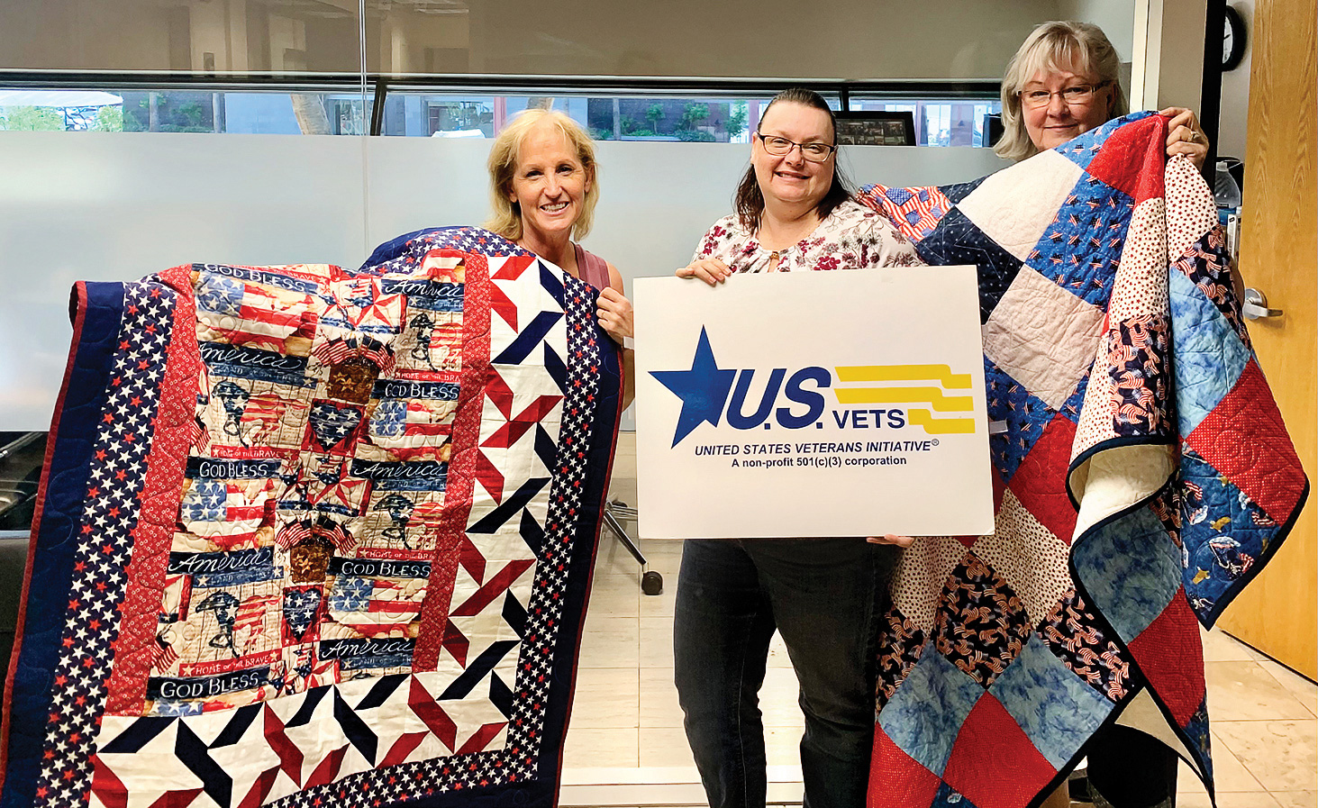 Jody Edwards (left) and Diana Jones (right) presented quilts to Kristen Kerns (center) for the U.S. Veterans organization in Phoenix.