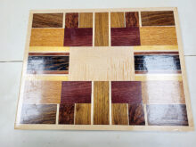 This is a one-of-a-kind serving tray made from a variety of woods. It measures 12.5-inches by 16.5 inches.
